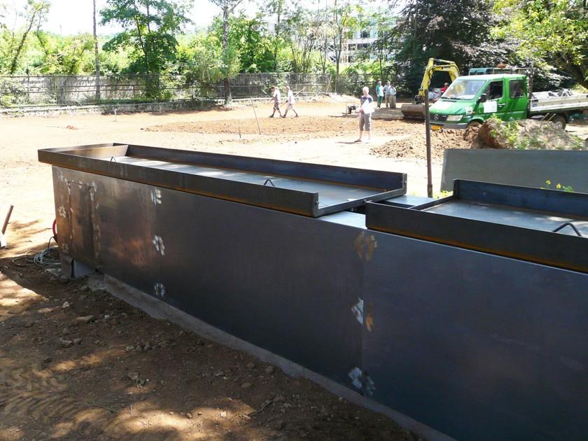 Couvre-murs corten soudés et assemblés sur mur béton